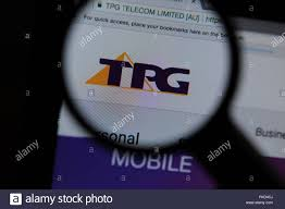 The TPG Capital website seen through a magnifying glass Stock Photo - Alamy