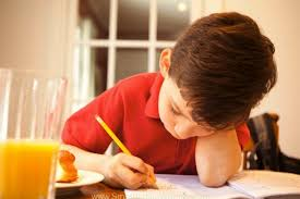 how to develop good writing skill in your child smart n women boy at table drawing pencil