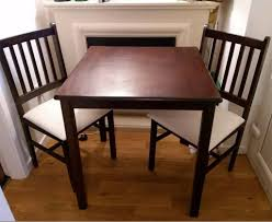 small dark wood dining table 2 chairs free delivery 0531