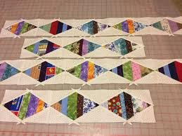 Design wall 10/2/17 string pieced border – Always Quilts & ... that I would put a pieced border on it. I was surprised at how quickly  I was able to make these. Now to get them finished up and on to the quilt. Adamdwight.com