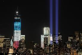 let the flags fly and the tears flow on the eye the tribute in light shines above the world trade center