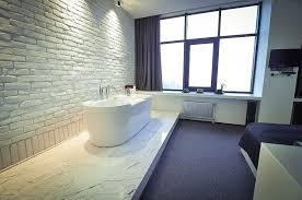 bathrooms with brick walls