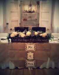 Burlap Round Table Overlays Head Table Backdrop Of Vintage Doors And Chandelier With Burlap
