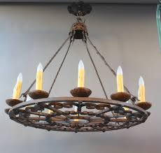 this is a simple and elegant spanish revival large scale wrought iron chandelier circa