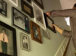 create a gallery wall in a stairwell