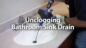 to unclog a bathroom sink drain in the wall