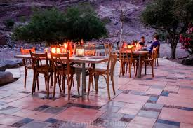 Restaurants outside seating area lightened by candles in a dry landscape stock image our image licences