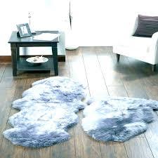 large sheepskin rugs australia gray fur rug black faux extra mount mercy universi extra large sheepskin rug