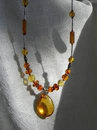 fully dressed amber silver necklace adorned with a fossil insect pendant