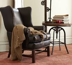awesome pottery barn brown leather upholstered wingback chair with nailhead trim and wooden legs