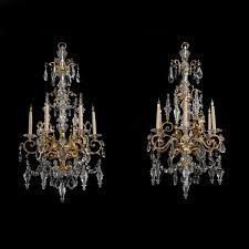 a near pair of cut glass and gilt bronze six light chandeliers