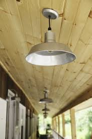 on the porches where guests access their rooms galvanized original warehouse pendants line the walkways these american made ceiling lights bring classic