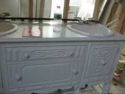 antique sideboard turned into bathroom