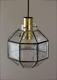 mid century modern four large minimalist iron glass pendant lights by glashütte limburg 1960s