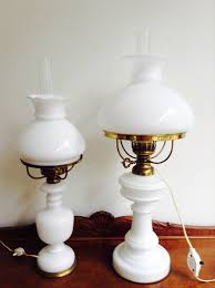 couple of milk glass oil lamps