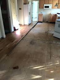 remove adhesive from wood floor remove tile