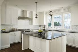 new custom kitchen with white cabinets and solid surface island