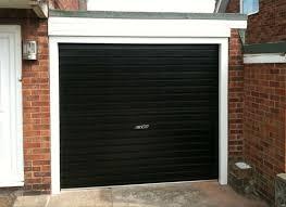 black garage doorRoller  Protec Garage Doors Ltd