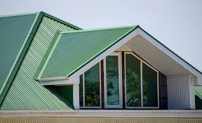 corrugated metal roofing panels in green coating installed