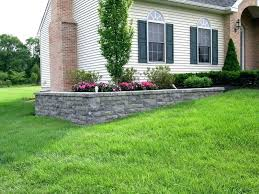 flower bed retaining wall a retaining wall is used on this project to level the planting flower bed retaining wall