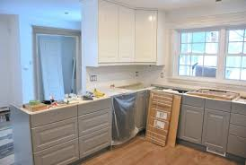 a gray and white kitchen makeover using ikea cabinetry quartz countertops subway tile