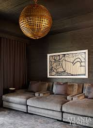 the television room exudes a co like appeal light fixture aerin lauder through circa lighting