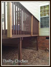 i then stained the corner post and board under rail facing into deck with solid stain by olympic the color is white deck b15