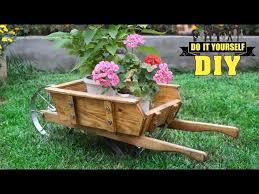 diy wooden wheelbarrow in the garden
