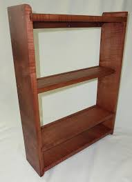 picture of curly cherry wall shelf