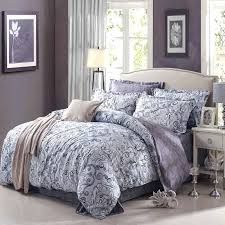 comforter cover from ikea with classic fl motif a bed frame with headboard white bedside table