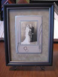 framed antique photo with wedding bands