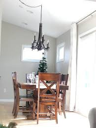 chandelier over dining table swag for how to a lighting above height