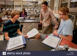 teen high school chemistry students discuss their homework stock stock photo teen high school chemistry students discuss their homework assignments before class in san clemente ca