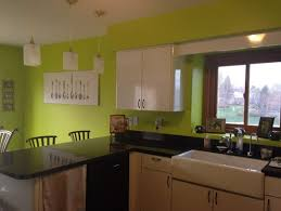 I hate this green color in my kitchen and don't know what color to paint  it! Everyone tells me medium grey, but I feel like that will look too manly!