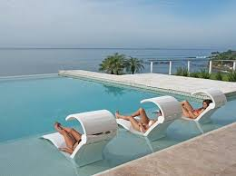 In pool furniture Diy Ledge Lounger Inpool Furniture Is The Perfect Finishing Touch To Any Pool Scene Stylish Durable And Comfortable Ledge Lounger Adds Instant Luxury To Pool Furniture Supply Ledge Lounger Inpool Furniture Is The Perfect Finishing Touch To