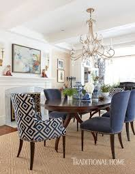 textures mix and mingle in the formal eating area where nailhead trimmed chairs wear sensuous cut velvet and walls are clad in nubby gr cloth