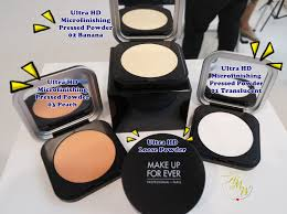 a photo of make up for ever ultra hd microfinishing pressed powder and loose powder in