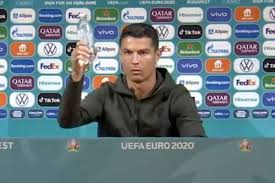 Cristiano Ronaldo removes Coca Cola bottles from Euro 2020 press conference  and tells people to drink water as Portugal captain prepares for record  breaking fifth tournament