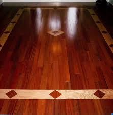 brazilian cherry hardwood floor with a red oak inlay design. Great design  for an enterance