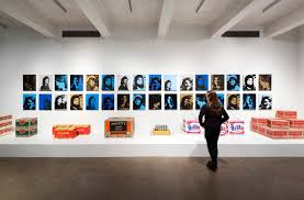 Images 2 home office radio museum collection Motorola Woman With Brown Hair Dressed Entirely In Black Faces Display Of Andy Warhols Works Home The Andy Warhol Museum