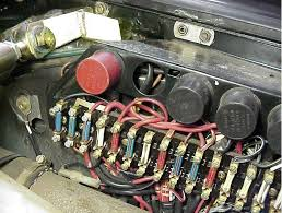 fusebox on a porsche 911 sc pelican parts technical bbs there s a big plastic rectangular cover about 10 inches long over the top of the fuses and relays the plastic cover has a map of which fuse is for which