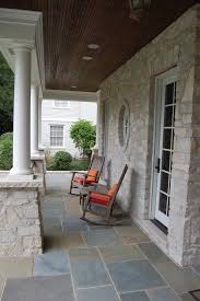 Exceptional Traditional Front Porch Grey Rocking Chairs Orange Accent Pillows Natural  Stone Exterior Walls Grey Tiles Floors