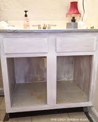 step by step to repainting bathroom cabinets priming bathroom cabinets