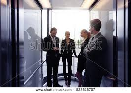 people talking in elevator. business team going on elevator and talking people in l