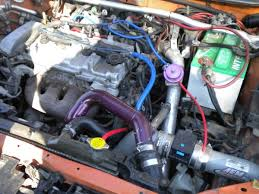 2003 mazdaspeed protege vacuum hose routing help this is the only picture of the engine bay i have see the mess of hoses cheap weak silicone hose not the good stuff what a mess