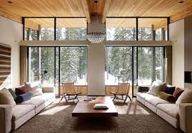 Vaulted Living Room Decorating Glass Wall With Black Frames And Brown Wooden Floating Table On