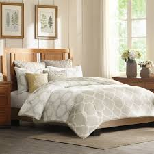 nicole miller bedding with wooden headboard and wall frame design also wooden nightstand for modern bedroom