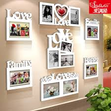get ations love the combination of wood frame wall white wood frame photo frame ornaments creative living room