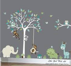 enchanted interiors premium self adhesive fabric nursery wall art stickers jungle wall decals featuring a safari tree swinging monkeys a giraffe  on baby room jungle wall art with enchanted interiors premium self adhesive fabric nursery wall art