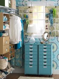 sort stow and organize a walk in closet in ways that reflect your personal style this small walk in closet lives large and lovely thanks to pretty